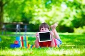 picture of homework  - Child in school with tablet pc - JPG
