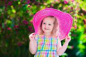 stock photo of birthday hat  - Little cute girl with flowers - JPG