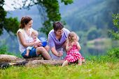 image of mother baby nature  - Family on summer hike - JPG