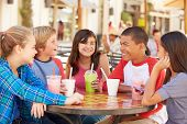stock photo of 11 year old  - Group Of Children Hanging Out Together In Caf - JPG