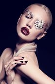 pic of fantastic  - fashion studio portrait of beautiful sexy woman with blond hair with fantastic makeup with bijou accessories - JPG