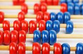 stock photo of subtraction  - closeup of a blue and red abacus - JPG