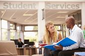 stock photo of tutor  - College Student Having Meeting With Tutor To Discuss Work - JPG