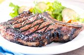 picture of rib eye steak  - a rare rib steak cooked to perfection on the grill - JPG