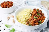 stock photo of millet  - buttered millet with tomato eggplant curry on the table - JPG