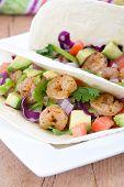 stock photo of cilantro  - High resolution two spicy shrimp taco with avocado - JPG