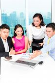 picture of counseling  - Asian banker team counseling client finance investment in bank office  - JPG