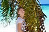 stock photo of racy  - Girl near palm trees on the beach in the Maldives - JPG