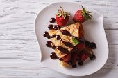 picture of crepes  - crepes with strawberries and chocolate on the table - JPG