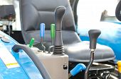 picture of levers  - Close up of levers set in agricultural vehicle - JPG