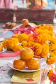 stock photo of marigold  - Orange on dish in chinese shrine for making merit in chinese new year with marigold flower background - JPG