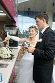 groom spending money on bride