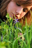Girl Bent Over To The Flower