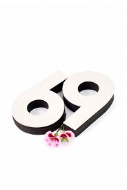 stock photo of coitus  - Picture of a Number 69 on a white back - JPG