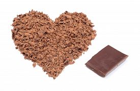 picture of grating  - Closeup of heart shaped grated chocolate and portion of chocolate valentine heart of chocolate - JPG