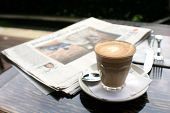 Cup Of Coffee With News Paper On Table