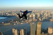 picture of aerobatics  - BASE Jump off the top of the Jin Mao Tower in Shanghai China at sunrise - JPG