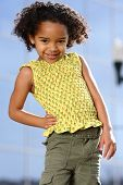 stock photo of young girls  - young african american girl does fashion photo shoot outdoor