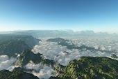 A mountain range with the valleys in the clouds
