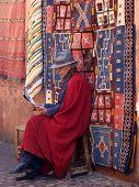 Moroccan Man Selling Carpets