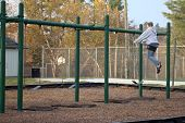 stock photo of swingset  - A female swinging on a swingset on a cold winter day - JPG