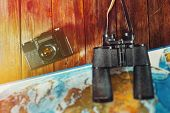 Adventure Journey Travel Scout Journey Concept. Vintage Film Camera, Map And Binoculars On Wooden Ta poster
