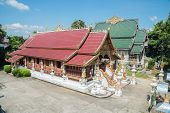 Wat Ming Muang a beautiful temple in Chiang rai province of Thailand from high angle view.