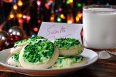 stock photo of christmas party  - A plate of Christmas cookies and a glass of milk left out for Santa Claus - JPG