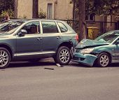 Image Of A Auto Accident Involving Two Cars. poster