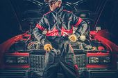 Vintage Classic Car Mechanic. Caucasian Professional Mechanic In Front Of Retro Vehicle. poster