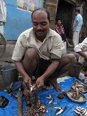 Man Selling Fish At A Street Market