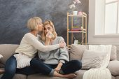 Adult Mother Calming Down Daughter, Empathizing, Embracing, Spending Time Together At Home On Weeken poster