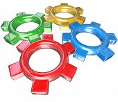 Four colorful gears -- one green, red, blue and gold -- turn in unison to symbolize synergy, coopera