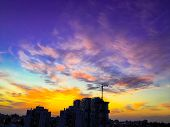 An Amazing Dramatic Cloudy Sunset Over The City And A Beautiful Dramatic Sky With Clouds. poster