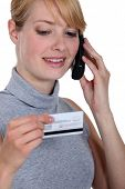 Woman on the phone with her credit card company