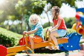 Kids On Playground. Children Play In Summer Park. poster
