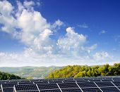 green energy solar plates to provide mountain valley village
