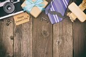 Happy Fathers Day Gift Tag With Top Border Of Gifts, Ties And Decor On A Rustic Wood Background. Top poster