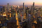 An Aerial Of Chicago Skyline At Night poster