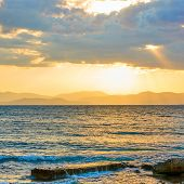 Sunset with island on the horizon -- Sundown seascape - landscape poster