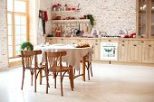 Bright Spacious Dining Room With Large Wooden Oval Table. Room With A Wooden Dining Table, Chairs An poster