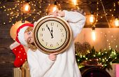 Woman Santa Hat Hold Vintage Clock. Time To Celebrate. New Year Countdown. Merry Christmas. Time For poster
