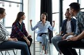 Psychotherapist Working With Patients In Group Therapy Session Indoors poster