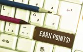 Conceptual Hand Writing Showing Earn Points. Business Photo Text Collecting Scores In Order Qualify  poster