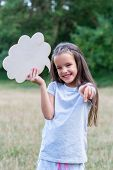 Pretty happy smiling thinking little girl pointing with her finger at camera, summer nature outdoor  poster