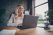 Low Below Angle View Photo Of Cheerful Beautiful Blonde Haired Entrepreneur Sitting At Desktop With  poster