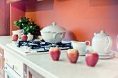 kitchen interior with fruits and dishes  on  countertop (beautiful Depth Of Field effect)