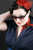 stock photo of rockabilly  - Portrait of a young girl dressed in Rockabilly fashion - JPG