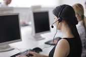 pic of telemarketing  - business people group with  headphones giving support in  help desk office to customers - JPG