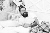 Pajamas Style. Happy Dad Relaxing Bedroom. Father With Funny Hairstyle. Freaky Hipster Relax In Bed. poster
